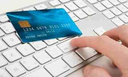 Credit card laying on laptop keyboard